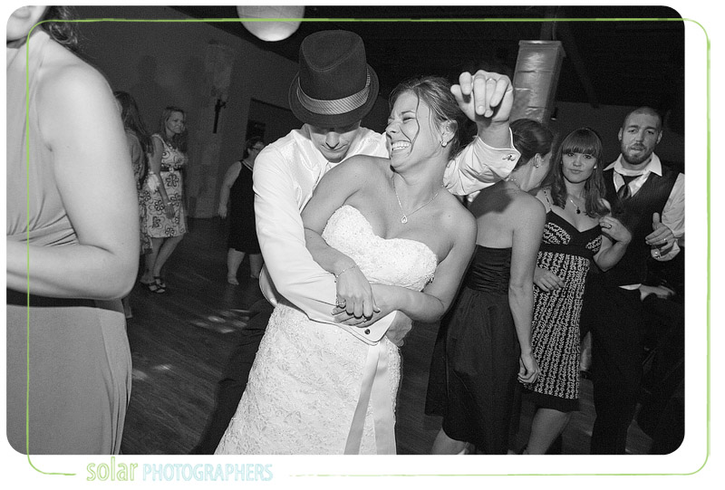 Bride and groom dancing together at their wedding reception.