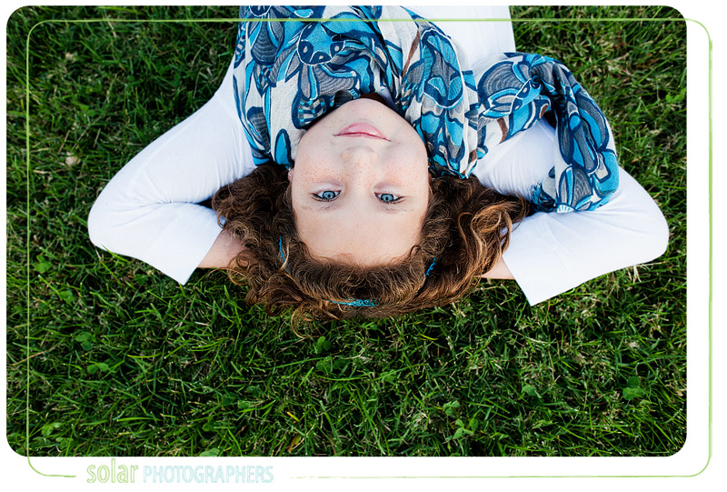 Awesome picture of a girl laying in the grass.