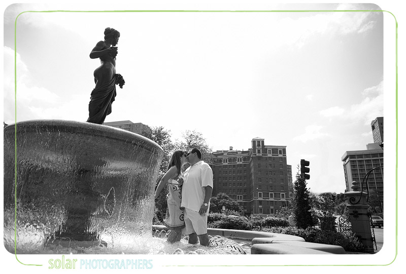 Couple playing in a fountain on the plaza.