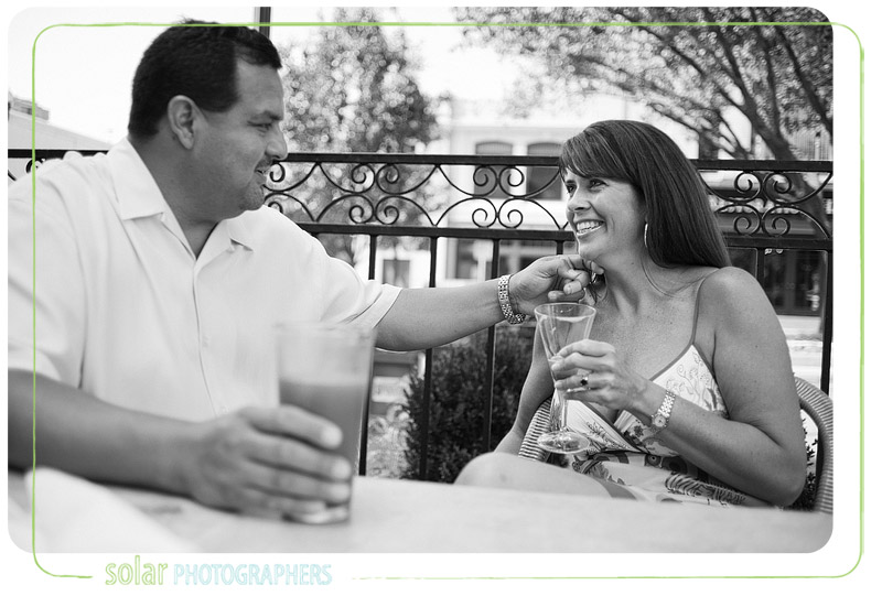 Couple shares a drink at the Cheesecake Factory during their engagement session.
