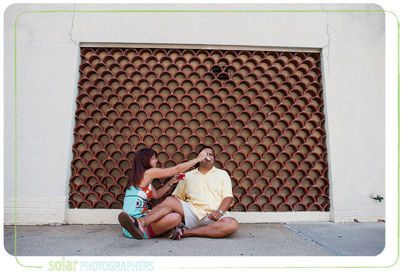 Fun couple shares ice cream together for their engagement pictures.