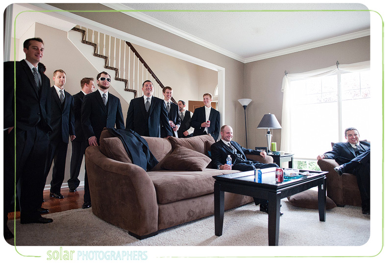 Groomsmen watching football.