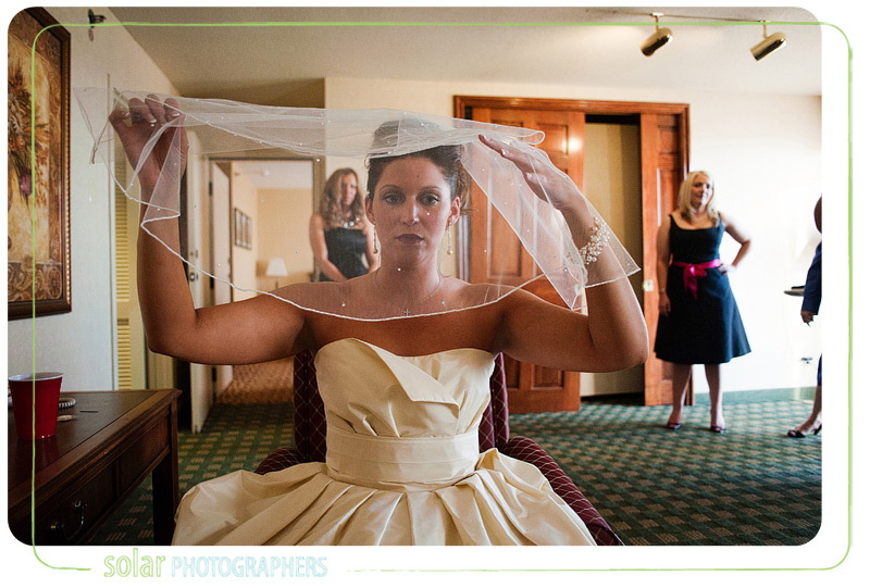 Bride fixes her veil before her wedding ceremony in Kansas City.