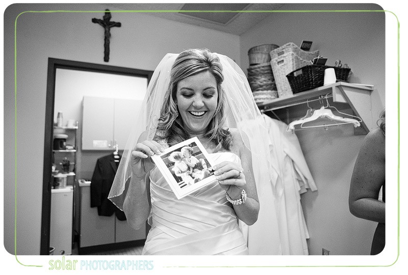 Bride opens her card from her groom and laughs.