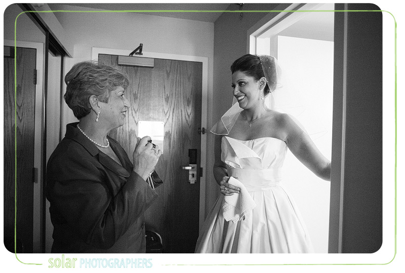 Bride and her mom share a touching moment before the wedding.