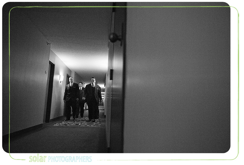 Groom walks with his groomsmen down the hall at the Marriott in downtown Kansas City.