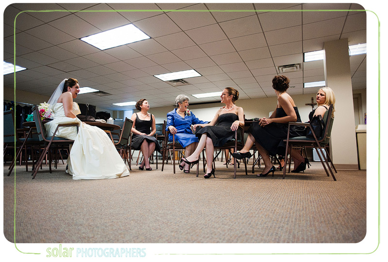 Bride waits with her bridesmaids for the wedding ceremony.