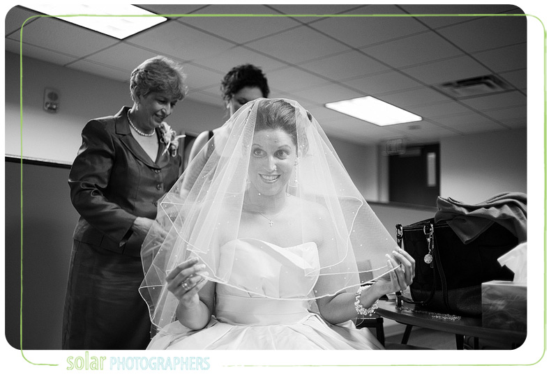 Bride gets veil fixed.