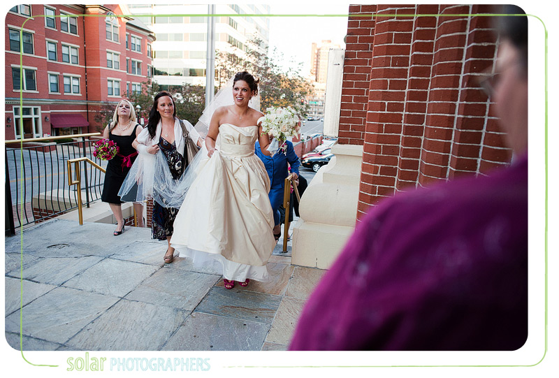 Bride enters the cathedral before here downtown Kansas City wedding.