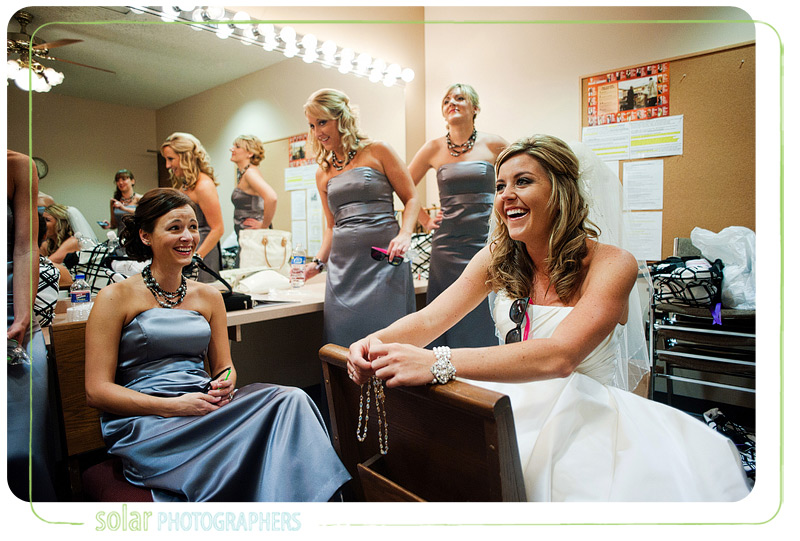 Candid shot of bride and her bridesmaids waiting for wedding ceremony to start.