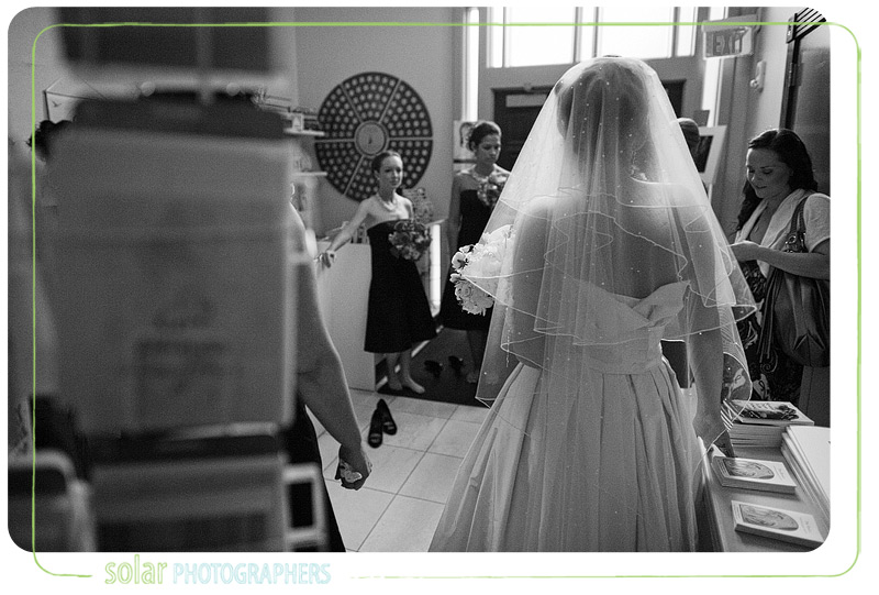 Bride waits with her bridesmaids for her wedding to start.
