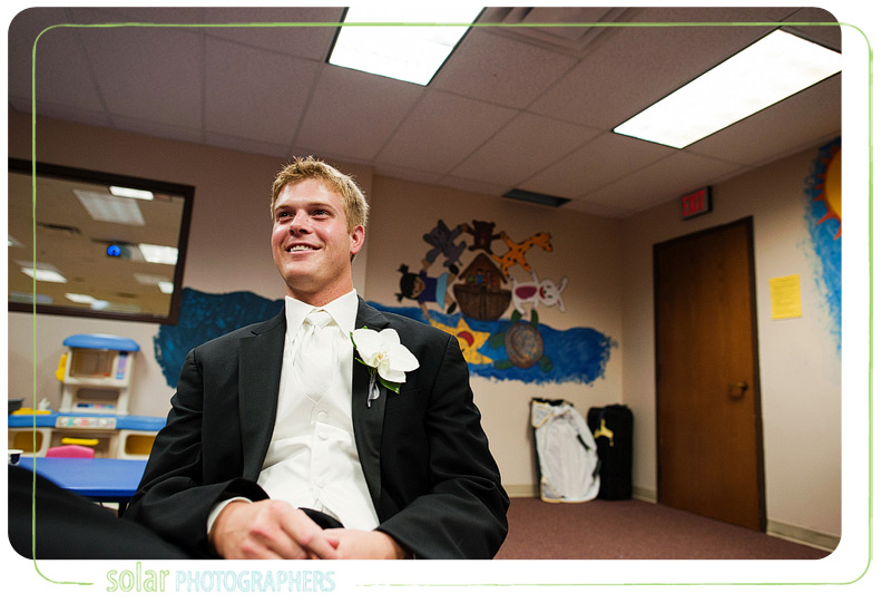 Groom waits patiently for his wedding to start.