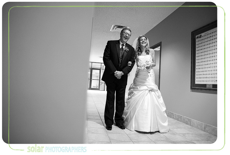 Bride waits with her dad for the wedding to start.