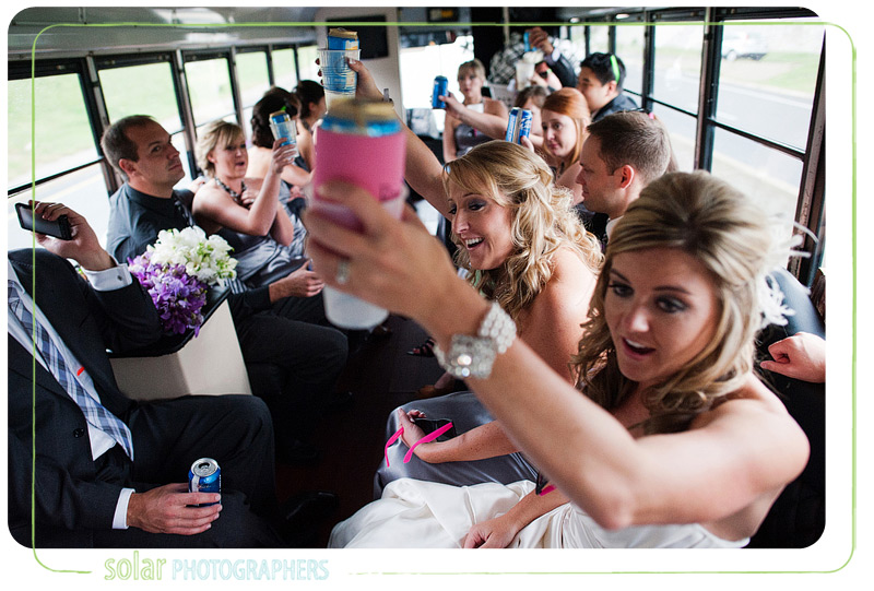 Bridal party toasts on a party bus in Kansas City.