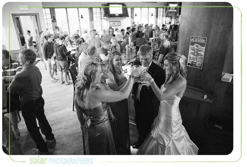 Bridal party toast at the Grand Falloon in Kansas City.