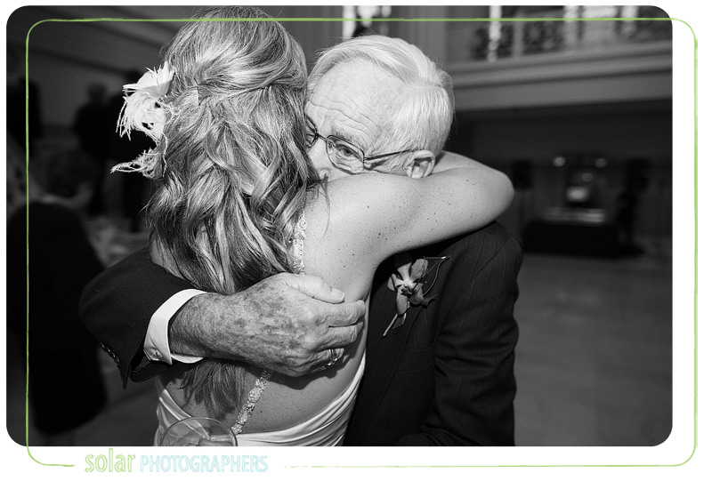 Grandpa hugs the bride.