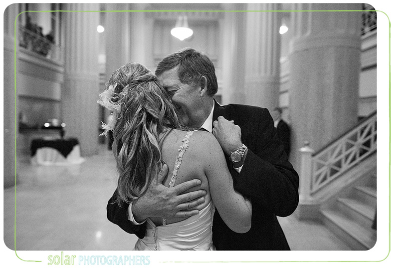 Emotional father daughter dance at a downtown Kansas City wedding.