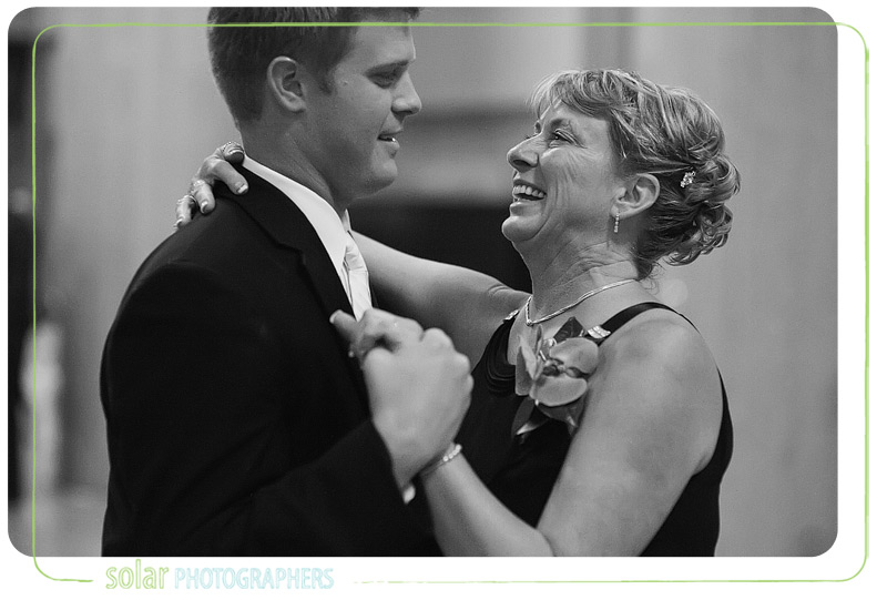 Emotional mother son dance at a Kansas City wedding reception.