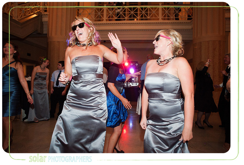 Bridesmaids dancing at a beautiful downtown Kansas City wedding reception.