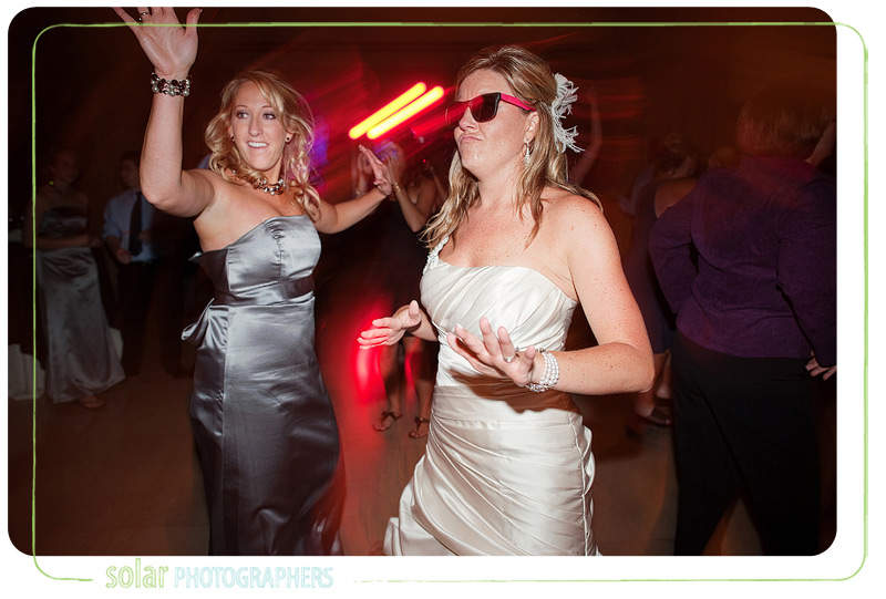 Bride dancing with her sister at her wedding reception.