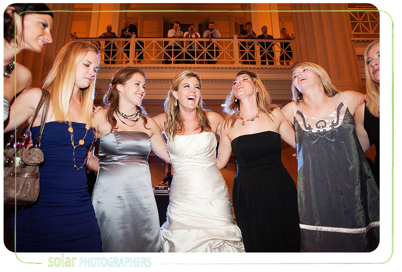 Sorority sisters singing together at a wedding reception.