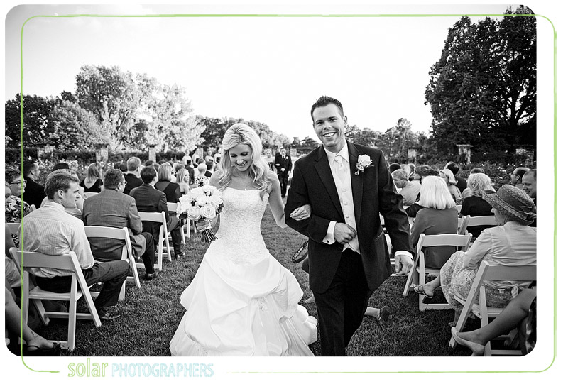 Awesome bride and groom exit after their Loose Park wedding ceremony in Kansas City.