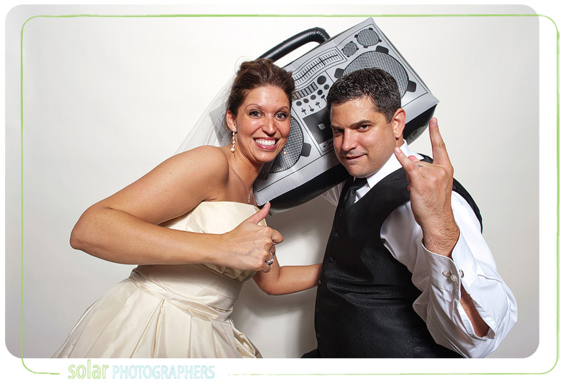 Bridesmaid and groomsman in the photo booth.