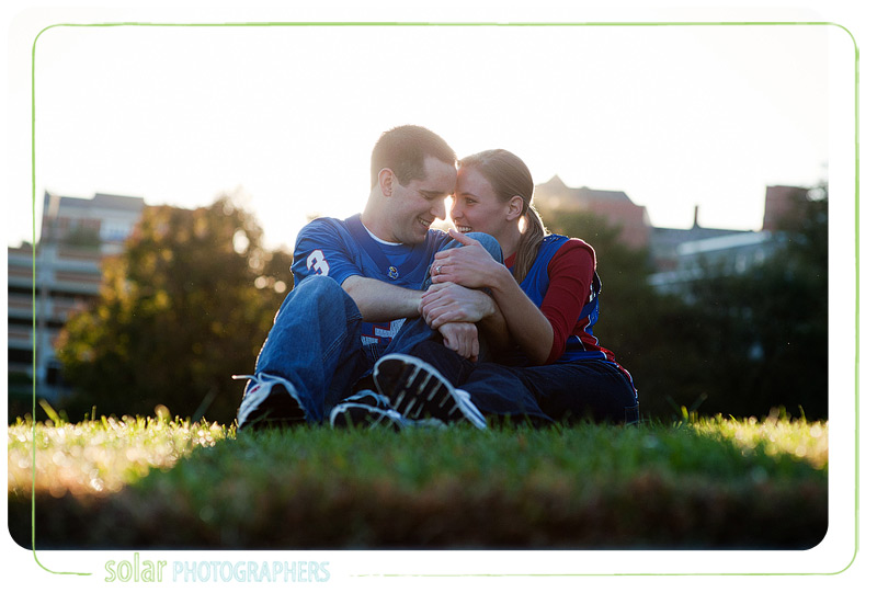 Couple laughing together by the KU football field.