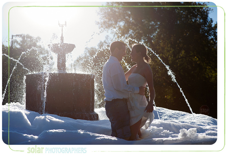 Couple in a soap filled fountain on KU campus.