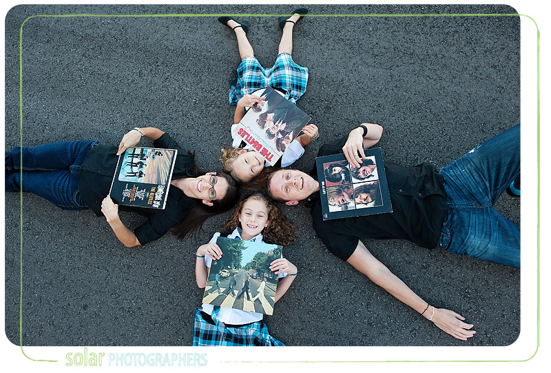 Fun family portrait with Beatles albums.