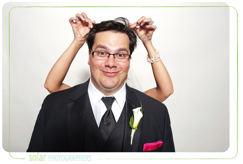 Fun photo booth picture of a bride and groom.