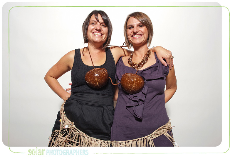 Two girls sharing the coconuts.