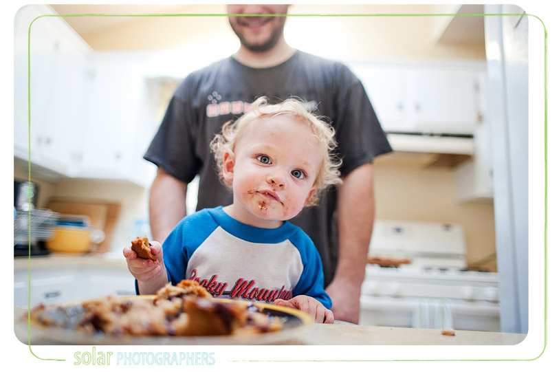 Cute little boy with food on his face.