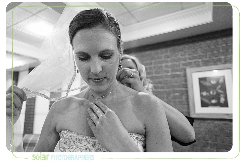 Mom helping bride get ready for her Kansas City wedding.