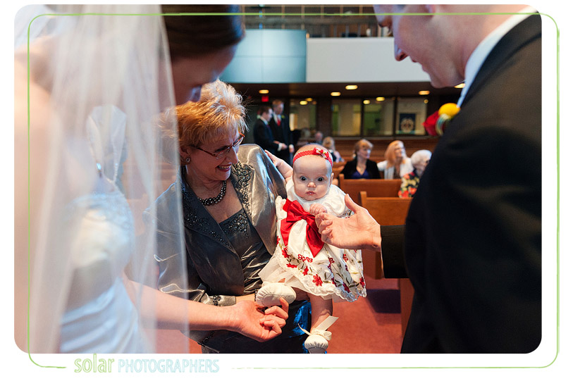 Cute baby at a wedding.