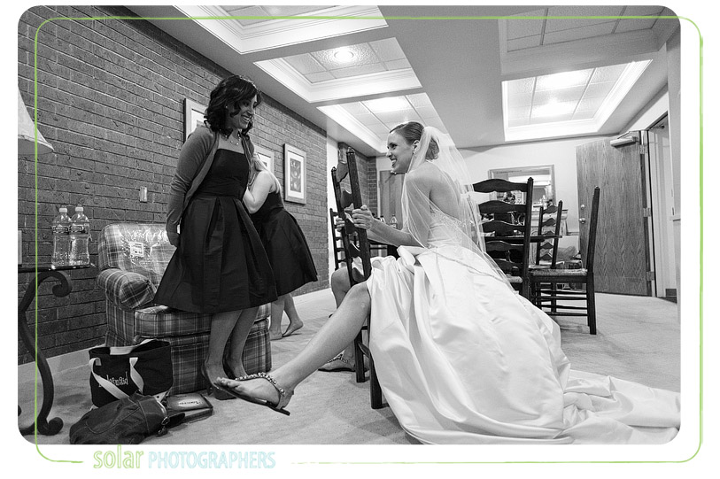 Bride laughs with her bridesmaids.