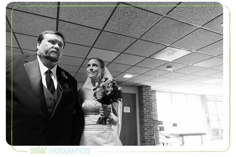 Bride looks at her dad before her wedding ceremony.