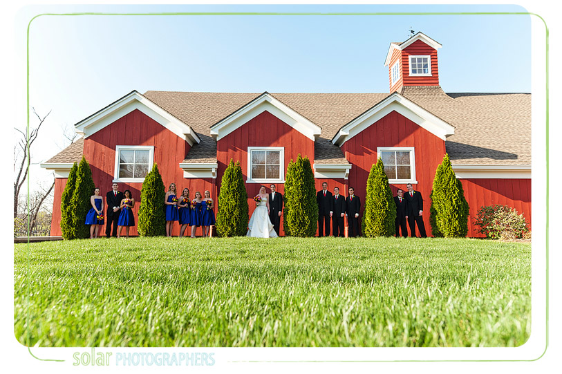 Sweet bridal party picture in front of the Lodge at Ironwoods Park.