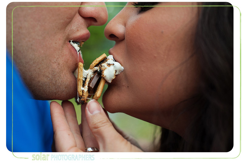Couple eating s'mores.