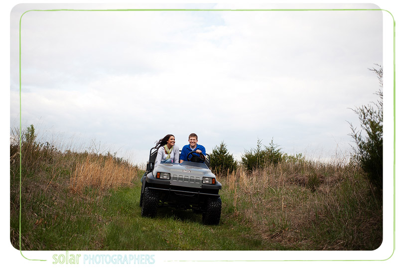 Couple riding a four wheeler.