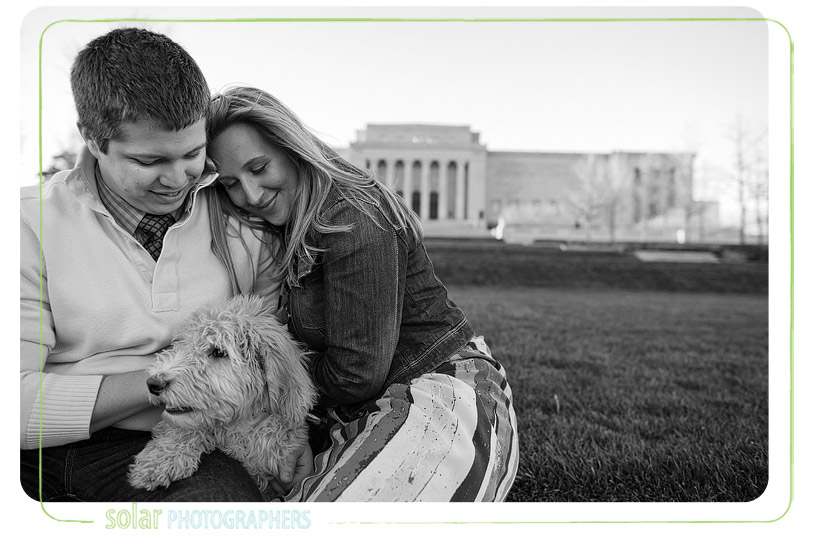 Couple snuggling with their puppy in Kansas City.