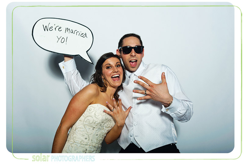 Bride and groom in their photo booth.