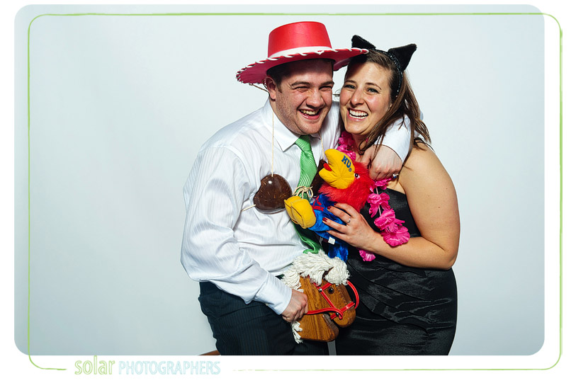 Couple having fun in a photo booth.