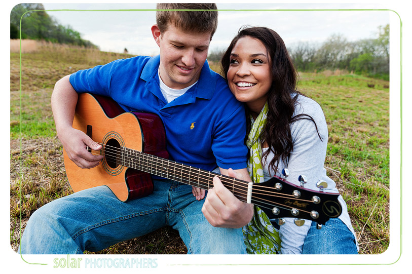 Playing guitar on an engagement shoot.