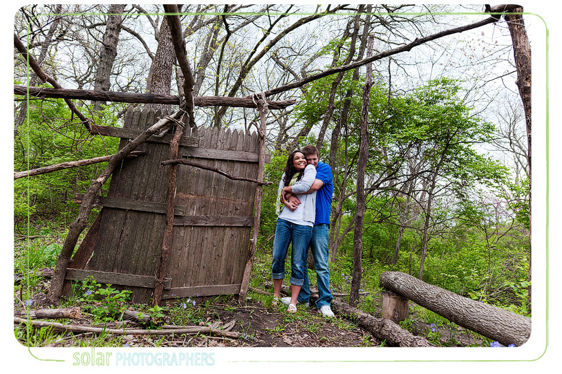 Sweet engagement portrait in a homemade fort.