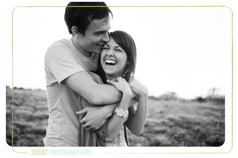 Laughter and love smiling and snuggling couple.