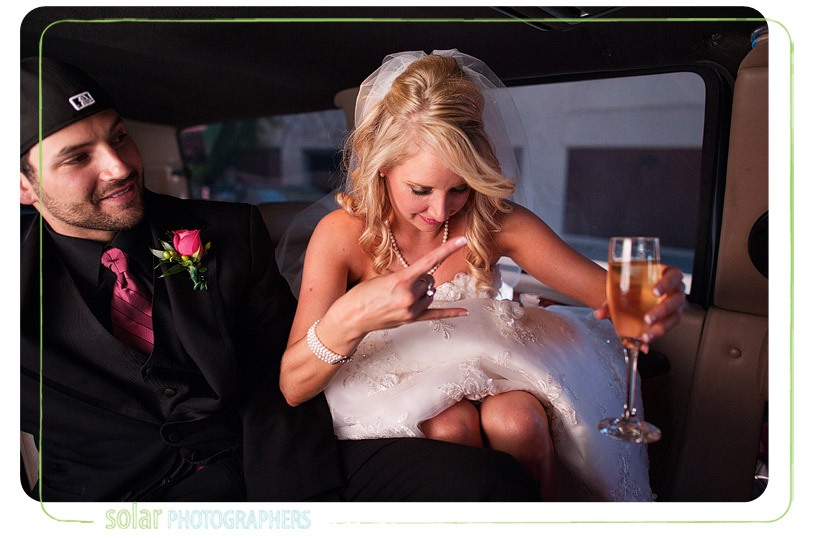 Bride dancing in a limo.