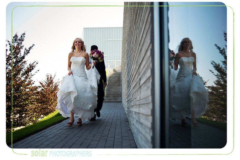 Candid bride and groom shot.