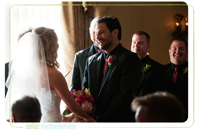 Happy groom getting married at loose mansion.