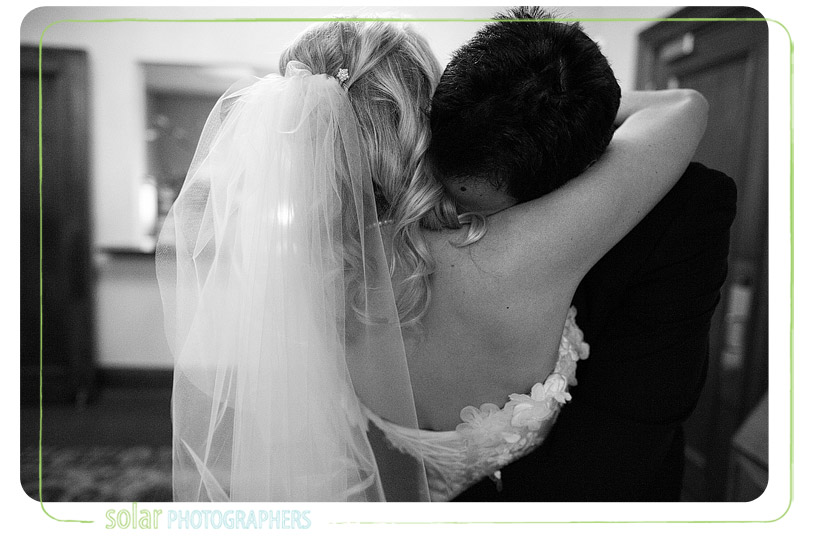 Emotional embrace after a wedding.